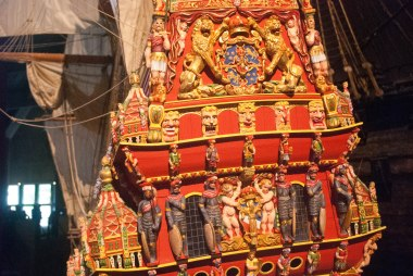 The detailed, colored carving of the miniature of the ship.