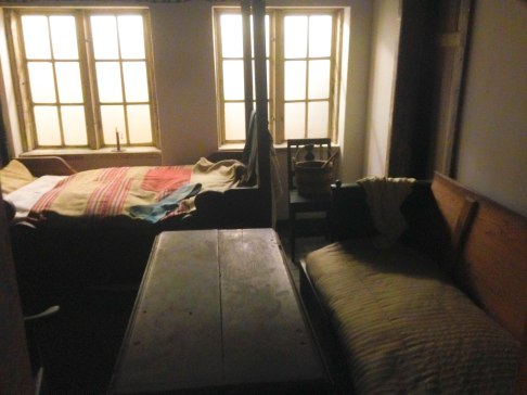 A living space of person from the lower-class economic background, also in the 1700s I believe. It consists of a bed, a couch and a table, and a small kitchen (in the left, not pictured).