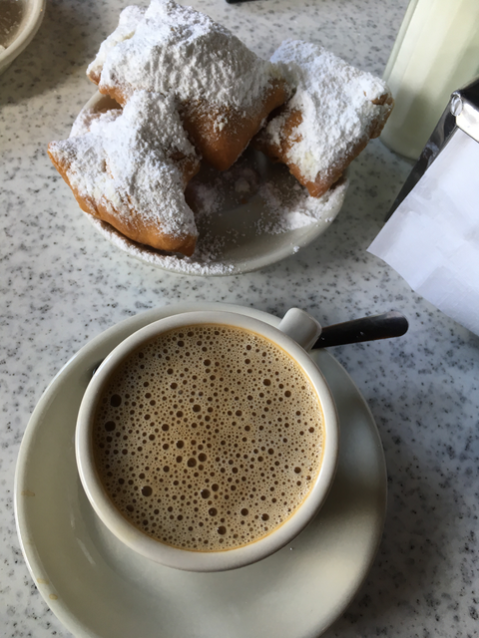 People watching while enjoying these beignets and cafe au lait, Cafe du Monde.